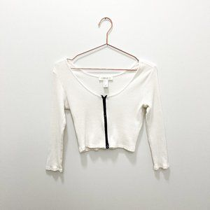 WHITE LONG SLEEVE CROP TOP WITH BLACK ZIP UP